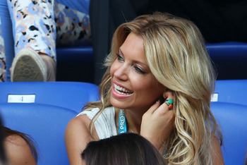 KHARKOV, UKRAINE - JUNE 13:  Sylvie Van Der Vaart looks on from the stand ahead of the UEFA EURO 2012 group B match between Netherlands and Germany at Metalist Stadium on June 13, 2012 in Kharkov, Ukraine.  (Photo by Joern Pollex/Getty Images)