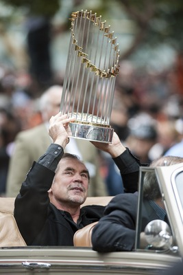 Bruce Bochy shows off the World Series trophy