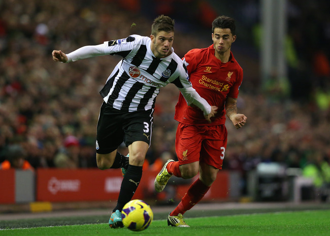 LIVERPOOL, ENGLAND - NOVEMBER 04:  Davide Santon of Newcastle United competes with Suso of Liverpool during the Barclays Premier League match between Liverpool and Newcastle United at Anfield on November 4, 2012 in Liverpool, England.  (Photo by Alex Live