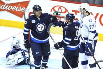 Nik Antropov of the Winnipeg Jets (left) with Evander Kane.