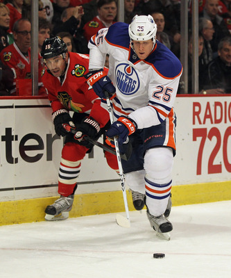 Edmonton Oiler Andy Sutton outskates Chicago Blackhawk Andrew Brunette.