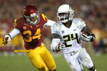 Is Kenjon Barner on the rise in this week's Heisman Trophy stock evaluation after an impressive performance against the USC Trojans?