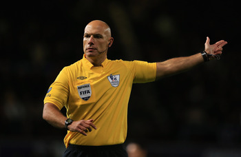 LONDON, ENGLAND - NOVEMBER 03: Referee Howard Webb gives a decision during the Barclays Premier League match between West Ham United and Manchester City at the Boleyn Ground on November 3, 2012 in London, England.  (Photo by Richard Heathcote/Getty Images