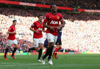 MANCHESTER, ENGLAND - NOVEMBER 03:  Patrice Evra of Manchester United celebrates scoring his team's second goal during the Barclays Premier League match between Manchester United and Arsenal at Old Trafford on November 3, 2012 in Manchester, England.  (Ph