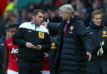 MANCHESTER, ENGLAND - NOVEMBER 03:  Arsenal Manager Arsene Wenger protests to Fourth Official Phil Dowd at the end of the Barclays Premier League match between Manchester United and Arsenal at Old Trafford on November 3, 2012 in Manchester, England.  (Pho