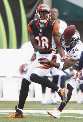 CINCINNATI, OH - NOVEMBER 04:  A.J. Green #18 of the Cincinnati Bengals battles for  the ball with Champ Bailey #24 of the Denver Broncos during their game at Paul Brown Stadium on November 4, 2012 in Cincinnati, Ohio.  (Photo by John Grieshop/Getty Image
