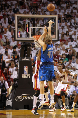 MIAMI, FL - JUNE 12:  Dirk Nowitzki #41 of the Dallas Mavericks attempts a shot against the Miami Heat in Game Six of the 2011 NBA Finals at American Airlines Arena on June 12, 2011 in Miami, Florida. NOTE TO USER: User expressly acknowledges and agrees t