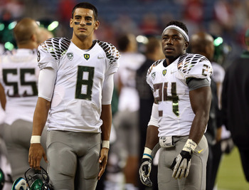 Will it be Marcus Mariota's arm or Kenjon Barner's legs that lead Oregon past Stanford and Oregon State?