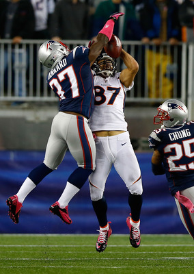 FOXBORO, MA - OCTOBER 07:  Eric Decker #87 of the Denver Broncos goes up for a pass in front of Alfonzo Dennard #37 of the New England Patriots during the game on October 7, 2012 at Gillette Stadium in Foxboro, Massachusetts.  (Photo by Jared Wickerham/Ge