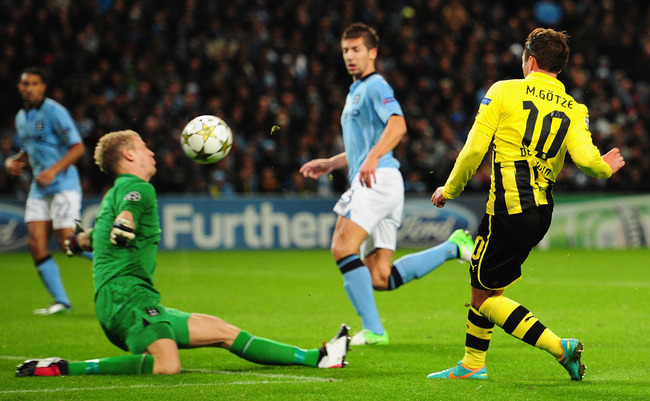 MANCHESTER, ENGLAND - OCTOBER 03:  Joe Hart of Manchester City blocks the shot of Mario Gotze of Borussia Dortmund during the UEFA Champions League Group D match between Manchester City and Borussia Dortmund at the Etihad Stadium on October 3, 2012 in Man