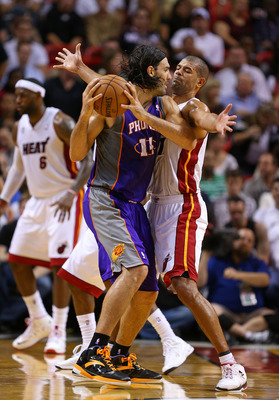 MIAMI, FL - NOVEMBER 05: Shane Battier #31 of the Miami Heat guards Luis Scola #14 of the Phoenix Suns during a game  at AmericanAirlines Arena on November 5, 2012 in Miami, Florida.  (Photo by Mike Ehrmann/Getty Images)