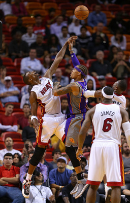 MIAMI, FL - NOVEMBER 05: Michael Beasley #0 of the Phoenix Suns is fouled by Chris Bosh #1 of the Miami Heat during a game  at AmericanAirlines Arena on November 5, 2012 in Miami, Florida.  (Photo by Mike Ehrmann/Getty Images)