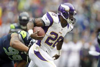 Adrian Peterson leads the NFL with 957 rushing yards.