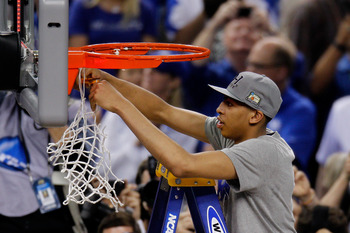 Kentucky's Anthony Davis cuts down the net after the Wildcats' National Championship victory over Kansas.