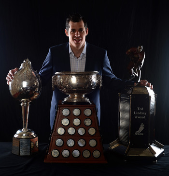 Malkin posing with his awards from the 2011-12 season.