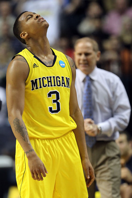 NASHVILLE, TN - MARCH 16:  Trey Burke #3 of the Michigan Wolverines reacts after a play against the Ohio Bobcats during the second round of the 2012 NCAA Men's Basketball Tournament at Bridgestone Arena on March 16, 2012 in Nashville, Tennessee.  (Photo b