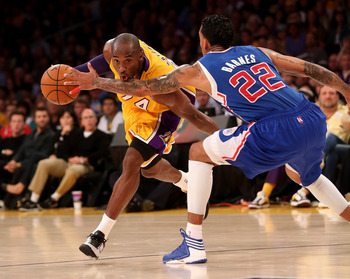 LOS ANGELES, CA - NOVEMBER 02:  Kobe Bryant #24 of the Los Angeles Lakers sdrives against Matt Barnes #22 of the Los Angeles Clippers at Staples Center on November 2, 2012 in Los Angeles, California.  The Clippers won 105-95.  NOTE TO USER: User expressly
