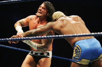 SYDNEY, AUSTRALIA - JUNE 15:  CM Punk wrestles Shelton Benjamin during WWE Smackdown at Acer Arena on June 15, 2008 in Sydney, Australia.  (Photo by Gaye Gerard/Getty Images)