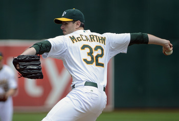 OAKLAND, CA - SEPTEMBER 05:  Brandon McCarthy #32 of the Oakland Athletics pitches against the Los Angeles Angels of Anaheim at O.co Coliseum on September 5, 2012 in Oakland, California.  (Photo by Thearon W. Henderson/Getty Images)