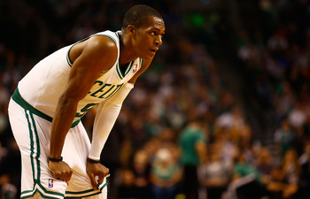 BOSTON, MA - NOVEMBER 02: Rajon Rondo #9 of the Boston Celtics takes a moment in between plays against the Milwaukee Bucks during the game on November 2, 2012 at TD Garden in Boston, Massachusetts. NOTE TO USER: User expressly acknowledges and agrees that