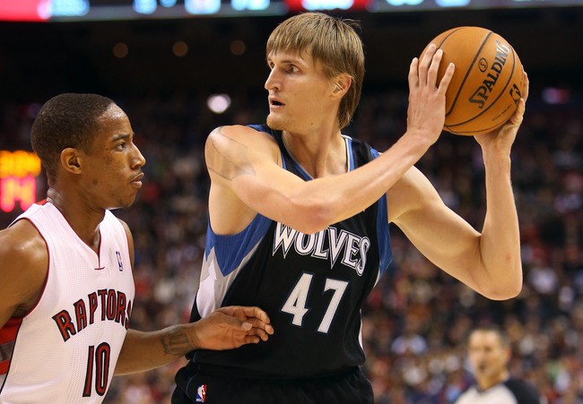 Nov 4, 2012; Toronto, ON, Canada; Minnesota Timberwolves forward Andrei Kirilenko (47) controls the ball as Toronto Raptors guard DeMar DeRozan (10) watches him at the Air Canada Centre. The Raptors beat the Timberwolves 105-86. Mandatory Credit: Tom Szcz