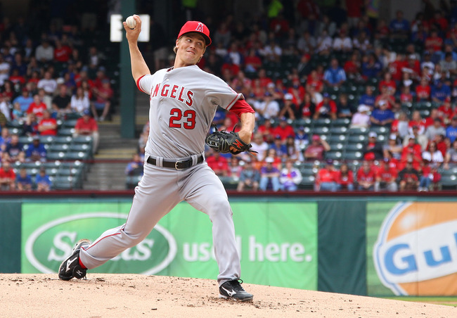 ARLINGTON, TX - SEPTEMBER 30: Zack Greinke #23 of the Los Angeles Angels of Anaheim pitches in game one of the double header against the Texas Rangers at Rangers Ballpark in Arlington on September 30, 2012 in Arlington, Texas.  (Photo by Rick Yeatts/Getty