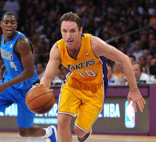 October 30, 2012; Los Angeles, CA, USA;    Dallas Mavericks point guard Darren Collison (4) looks on as Los Angeles Lakers point guard Steve Nash (10) drives to the basket in the second half of the game at the Staples Center. Dallas won 99-91. Mandatory C