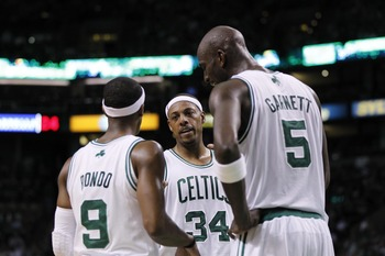 June 1, 2012; Boston, MA, USA; Boston Celtics small forward Paul Pierce (34) talks with point guard Rajon Rondo (9) and forward/center Kevin Garnett (5) during the third quarter against the Miami Heat in game three of the Eastern Conference finals of the