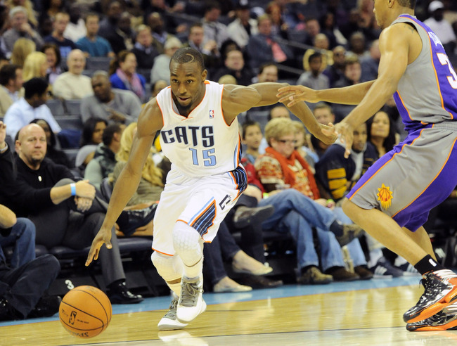 November 7, 2012; Charlotte, NC, USA; Charlotte Bobcats guard Kemba Walker (15) drives across the court during the game against the Phoenix Suns at Time Warner Cable Arena. Suns win 117-110. Mandatory Credit: Sam Sharpe-US PRESSWIRE