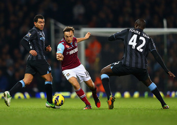 Mark Noble would bring a solid defensive presence to the England midfield.