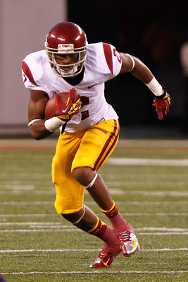 Sept. 8, 2012; East Rutherford, NJ, USA; Southern California Trojans wide receiver Robert Woods (2) carries the ball during the third quarter against the Syracuse Orange at MetLife Stadium. Mandatory Credit: Debby Wong-US PRESSWIRE