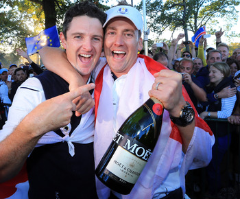 MEDINAH, IL - SEPTEMBER 30:  Justin Rose and Ian Poulter celebrate after Europe defeated the USA 14.5 to 13.5 to retain the Ryder Cup during the Singles Matches for The 39th Ryder Cup at Medinah Country Club on September 30, 2012 in Medinah, Illinois.  (P