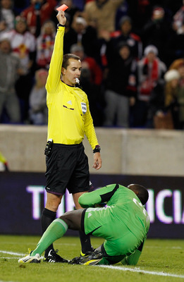 HARRISON, NJ - NOVEMBER 08:  Referee Mark Geiger issues a red card to Bill Hamid #28 of DC United during action against the New York Red Bulls in the Eastern Conference Semifinals at Red Bull Arena on November 7, 2012 in Harrison, New Jersey.  (Photo by M