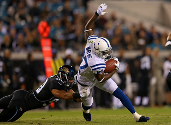 Reggie Wayne currently leads the league in receiving yards.