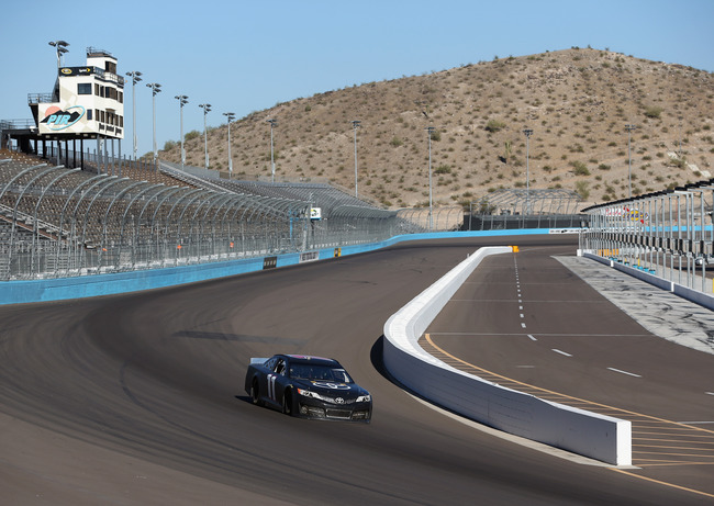 AVONDALE, AZ - OCTOBER 24:  Denny Hamlin drives the #11 FedEx Freight Toyota during NASCAR testing at Phoenix International Raceway on October 24, 2012 in Avondale, Arizona.  (Photo by Jeff Gross/Getty Images for NASCAR)