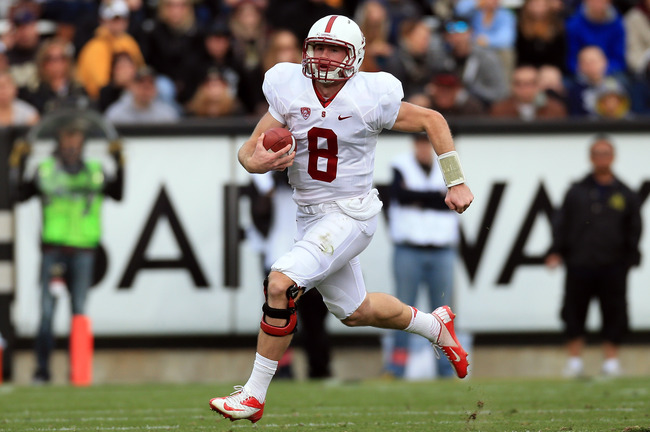 BOULDER, CO - NOVEMBER 03:  Quarterback Kevin Hogan #8 of the Stanford Cardinals scrambles against the Colorado Buffaloes at Folsom Field on November 3, 2012 in Boulder, Colorado. The Cardinal defeated the Buffaloes 48-0.  (Photo by Doug Pensinger/Getty I