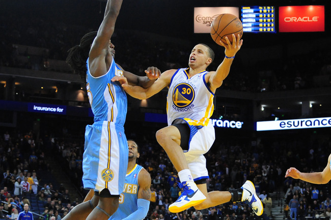 November 10, 2012; Oakland, CA, USA; Golden State Warriors shooting guard Stephen Curry (30) shoots the ball against Denver Nuggets small forward Kenneth Faried (35, left) during the second overtime at ORACLE Arena. The Nuggets defeated the Warriors 107-1