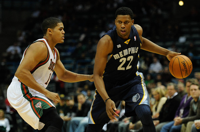Nov 7, 2012; Milwaukee, WI, USA;  Milwaukee Bucks forward Tobias Harris (15) guards Memphis Grizzlies forward Rudy Gay (22) at the Bradley Center.  Mandatory Credit: Benny Sieu-US PRESSWIRE