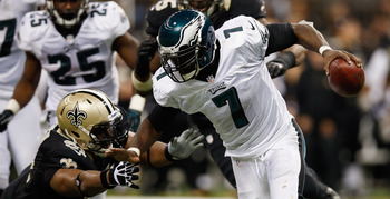 Eagles' QB Michael Vick under pressure against the Saints.