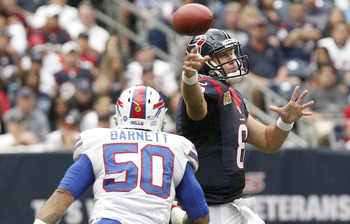 Texans' QB Matt Schaub about to take a hit from Bills' linebacker Nick Barnett.