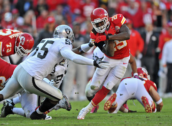 Chiefs' RB Jamaal Charles slipping a tackle against Oakland.