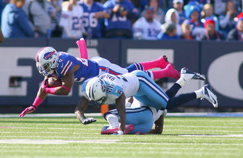 Bills' RB Fred Jackson getting taken down by a Tennessee defender.
