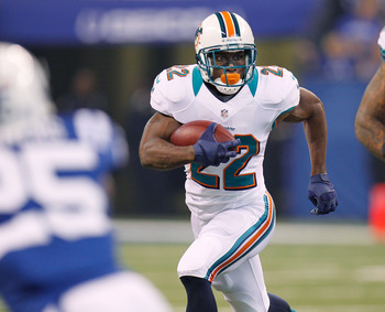 Dolphins RB Reggie Bush trucking down the field against the Colts.