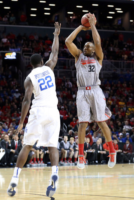 Nov 9, 2012; Brooklyn, NY, USA; Maryland Terrapins guard/forward Dezmine Wells (32) shoots over Kentucky Wildcats forward Alex Poythress (22) during the first half of the game at the Barclays Center Classic held at Barclays Center.  Mandatory Credit: Anth