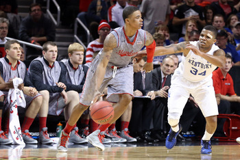 Nov 9, 2012; Brooklyn, NY, USA;  Maryland Terrapins guard Nick Faust (5) drives past Kentucky Wildcats guard Julius Mays (34) during the second half of the game at the Barclays Center Classic held at Barclays Center.  Mandatory Credit: Anthony Gruppuso-US