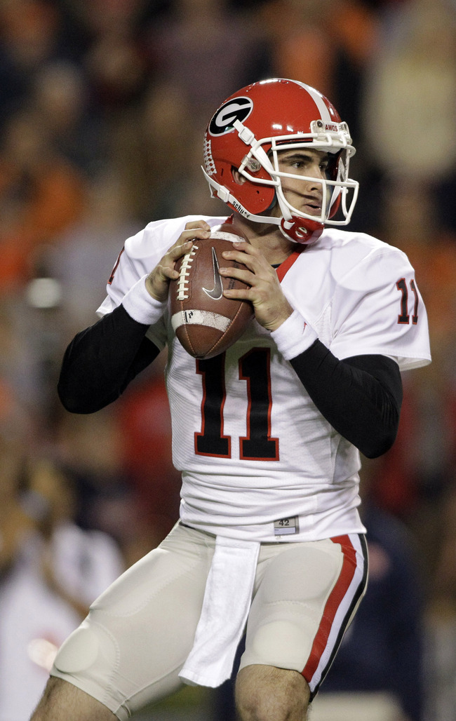 Nov 10, 2012; Auburn, AL, USA: Georgia Bulldogs quarterback Aaron Murray (11) drops back to pass against the Auburn Tigers during the first half at Jordan-Hare Stadium.  Mandatory Credit: John Reed-US PRESSWIRE