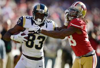 Dashon Goldson is unable to stop Rams' receiver Brian Quick from scoring.