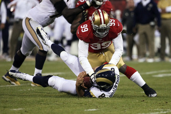 Aldon Smith collects one of his two sacks.