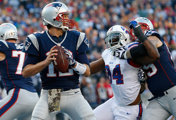 Mario Williams tries to get to Tom Brady