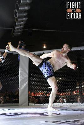 Ronald Leonard misses on a head kick attempt. (Photo credit: Sandy Hackenmueller of Fight to Finish Photography)